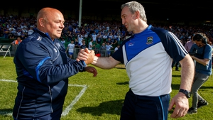 Derek McGrath (L) and Michael Ryan embrace at the final whistle of a thrilling encounter