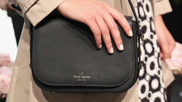 A model poses, clutch detail, at the Kate Spade New York presentation during Spring 2016