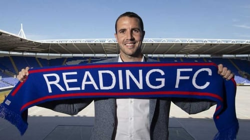 John O'Shea poses with his new club's scarf. Photo: Reading FC