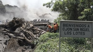 Rescuers search the tiny hamlet of San Miguel Los Lotes in Guatemala
