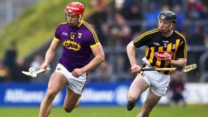 Lee Chin and Conor Delaney in action during the Allianz League semi-final, a game the Cats won comfortably by 12 points