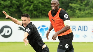 Usain Bolt (R) and Robbie Keane of the Rest of the World take part in training for Soccer Aid for UNICEF