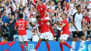 Marcus Rashford celebrates with Phil Jones, Jordan Henderson and Trent Alexander-Arnold after scoring England's opener