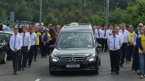 The funeral cortege arriving at St Mochonog's Church in Kilmacanogue