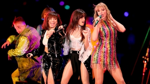 Charli XCX on stage with Camila Cabello and Taylor Swift