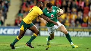 Ireland's Jacob Stockdale tackled by Marika Koroibete of Australia