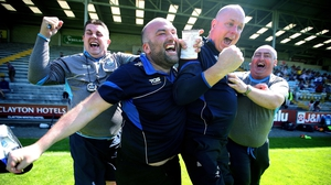 Waterford manager Tom McGlinchey and his back room team celebrate at the final whistle