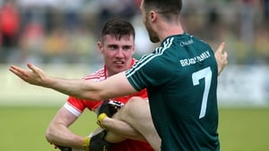Patrick Coney tussles with Kevin Flynn