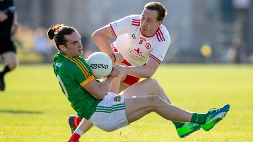 Meath's Cillian O'Sullivan and Colm Cavanagh of Tyrone