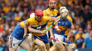 Clares' John Conlon battles with Séamus Kennedy and Donagh Maher of Tipperary