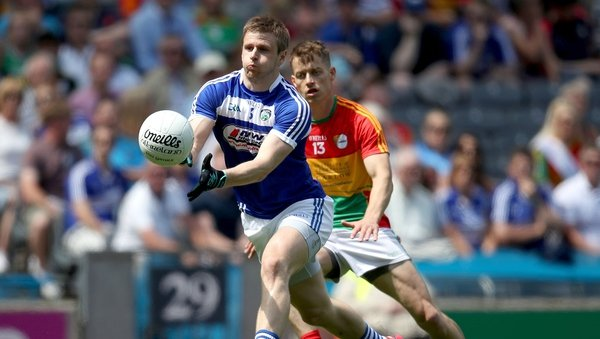Laois' Mark Timmons gets the ball away despite the attention of Paul Broderick
