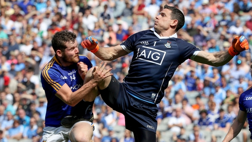 Will he or won't he? Cluxton was injured after this hit from Longford's James McGivney