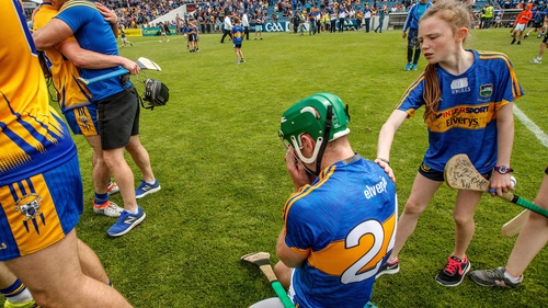 A young Tipperary fan consoles Noel McGrath following the defeat to Clare at Semple Stadium