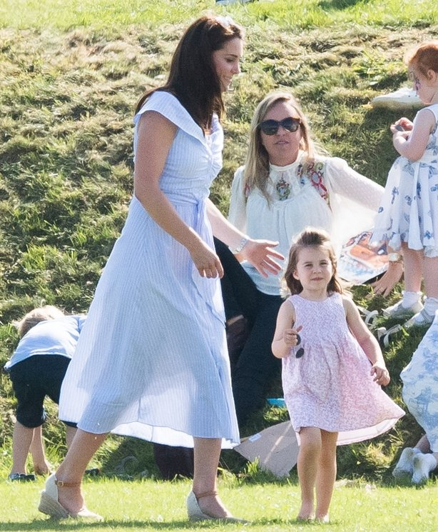Duchess of Cambridge and Princess Charlotte of Cambridge attend the Maserati Royal Charity Polo Trophy at Beaufort Park