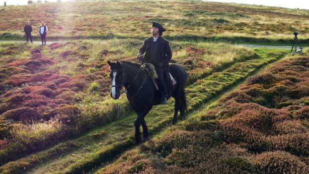 Aidan Turner rides Seamus over heathland on Gwennap Head on the Cornish coast during filming recently for series three of the BBC One hit Sunday night drama Poldark.