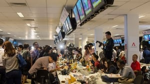Journalists report from the International Media Centre as the unprecedented meeting between the two leaders takes place