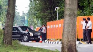 President Donald Trump's motorcade arrives at Capella Hotel ahead of North Korean leader Kim Jong-un's motorcade