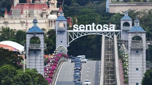The motorcade transporting North Korea's leader Kim Jong-un leaves Sentosa island after taking part in the summit