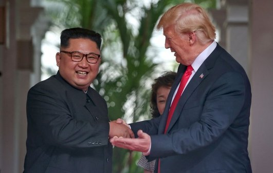 Trump and Kim sign joint letter at historic summit