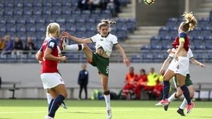 Leanne Kiernan gets her header away