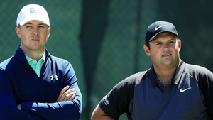 Jordan Spieth and Patrick Reed wait together during a practice round at the US Open