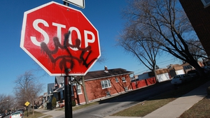 Gang graffiti on a road traffic sign