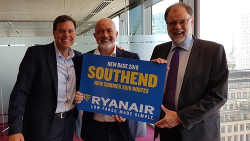 Warwick Brady (Stobart), David O'Brien (Ryanair), and Iain Ferguson (Stobart) celebrate the announcement