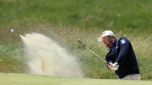 McDowell plays a bunker shot during US Open practice