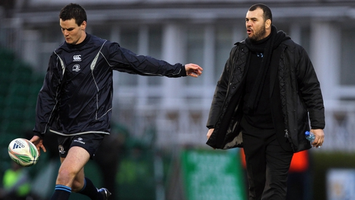 Johnny Sexton takes instructions from then Leinster head coach Michael Cheika prior to a Heineken Cup game in 2010