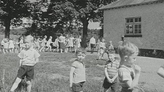 Children playing outside national school, County Leitrim (1968)