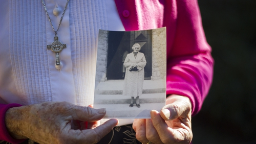 Sister Gabrielle holding a photo of her mother, Josephine Murray.  Photo by Emma Decker