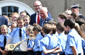 Prince Charles meets school children during a visit to Cork Naval Base