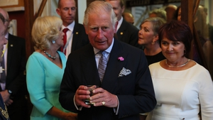 Prince Charles and the Duchess (L) attend a dinner at Crawford Art Gallery as part of their tour