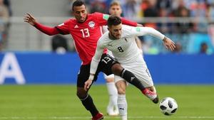 Mohamed Abdelshafy of Egypt tackles Nahitan Nandez of Uruguay