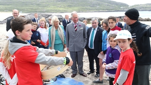 Charles and Camilla and Kevin 'Boxer' Moran (all centre), meet schoolchildren taking part in a project about plastic pollution on Derrynane beach, Co Kerry
