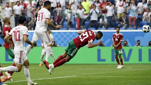 Morocco's Aziz Bouhaddouz scores the winner for Iran