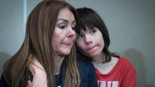 Billy Caldwell pictured with his mother Charlotte at Heathrow Airport