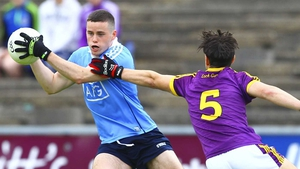 Dublin's Ross McGarry and Dylan Furlong of Wexford in action