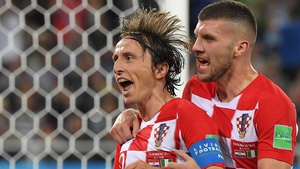 Luka Modric celebrates scoring a penalty with his teammate Ante Rebic
