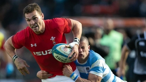 George North from Wales is tackled by Bautista Delguy from Argentina
