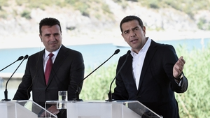 Greek Prime Minister Alexis Tsipras (R) and Macedonian Prime Minister Zoran Zaev speak prior to the signing ceremony
