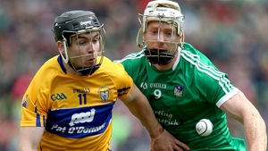 Tony Kelly of Clare and Cian Lynch of Limerick compete for possession