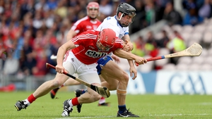 Bill Cooper wrestles for the ball with Jamie Barron as Cork eked out a victory over Waterford in Thurles