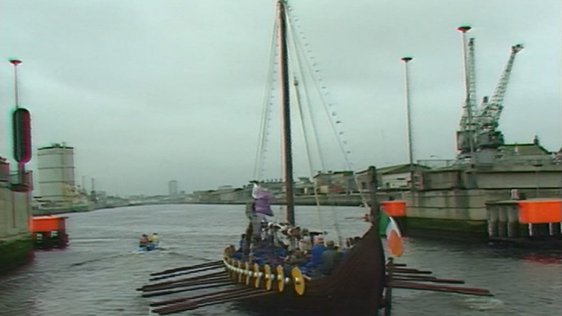 Replica Viking longship rows up the river Liffey (1988)