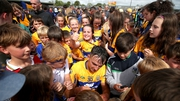 Clare's Peter Duggan signs autographs after the game