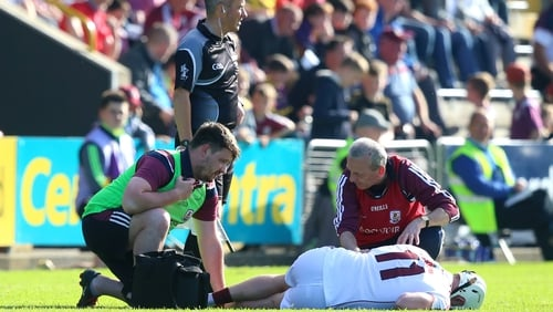 Joe Canning receives treatment on the Wexford Park pitch