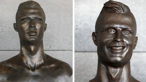 A new sculpture of the footballer (L) has replaced an earlier one (R) which gained cult popularity  last year