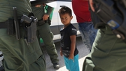 A boy and father from Honduras are taken into custody near the US-Mexico border