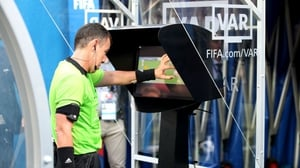 Referee Joel Aguilar reviews the VAR footage before awarding Sweden a penalty against South Korea