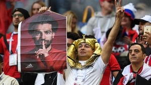 An Egypt fan holds up a poster of Mo Salah